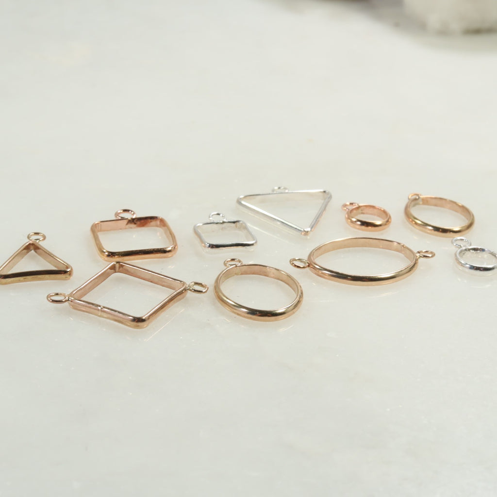 open bezels in silver gold and pink gold