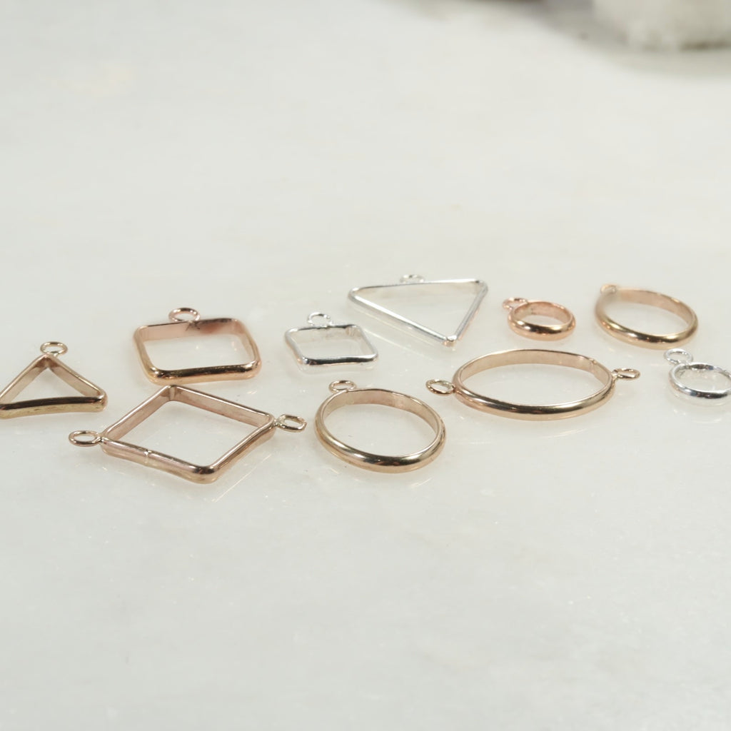 open bezels in silver, gold and pink gold
