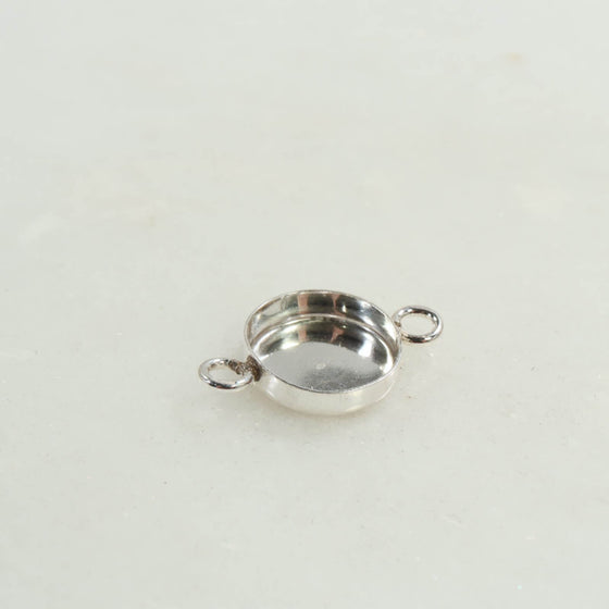 silver bezel cup with 2 rings