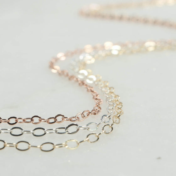 silver gold and pink gold chain