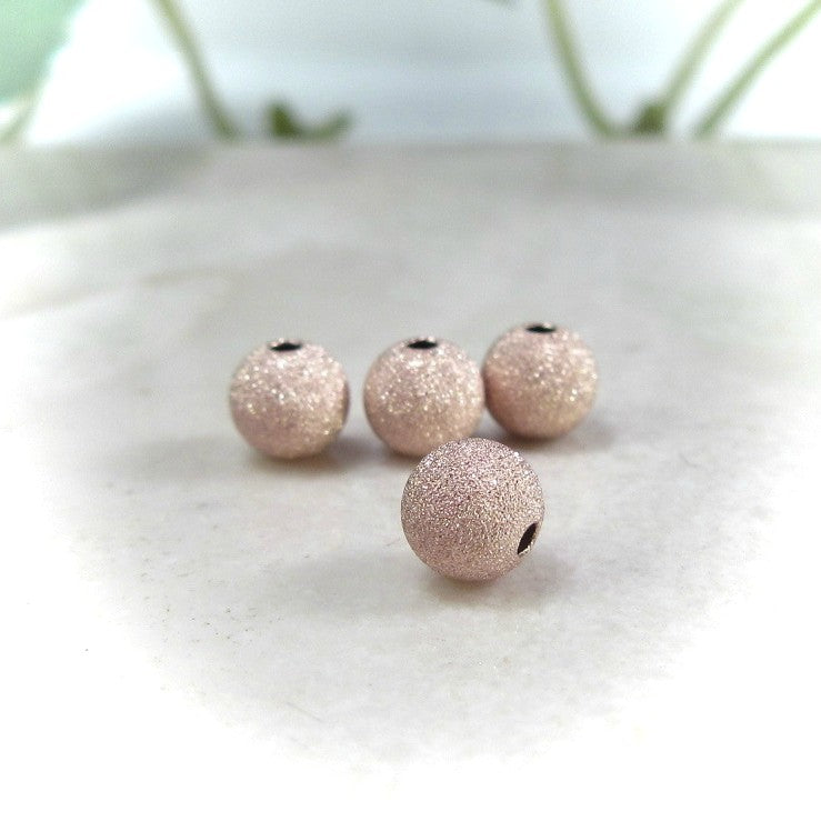 pink gold stardust beads