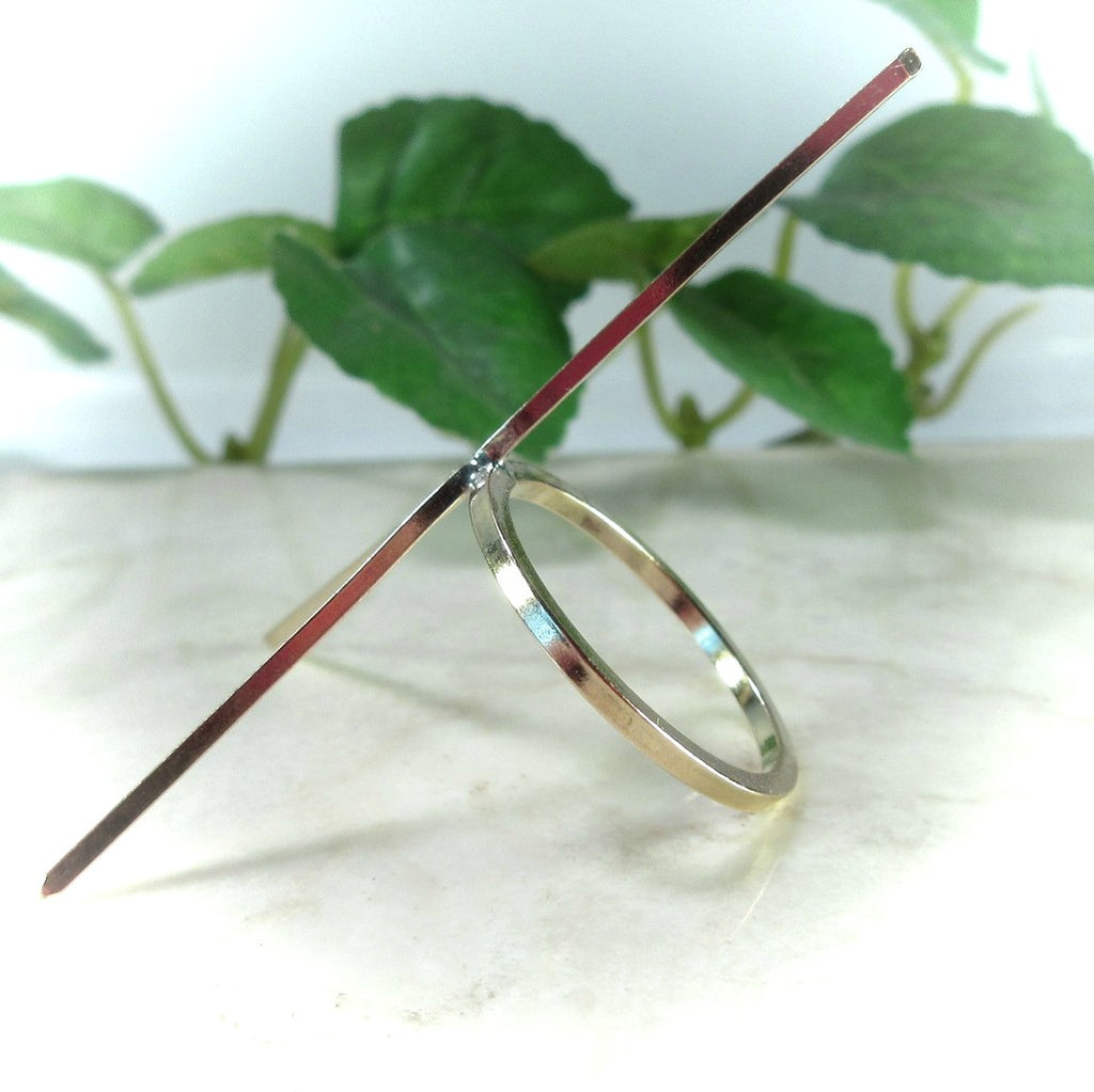 side view of gold square raw gemstone ring setting