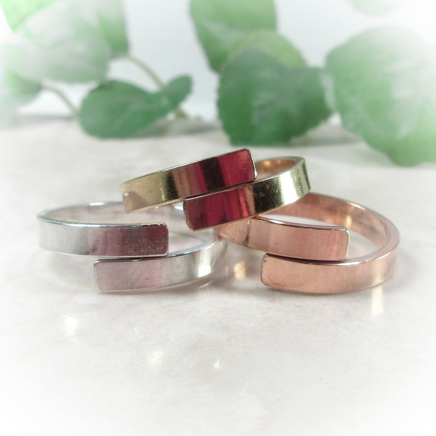 silver, gold and pink gold hand stamp ring blank
