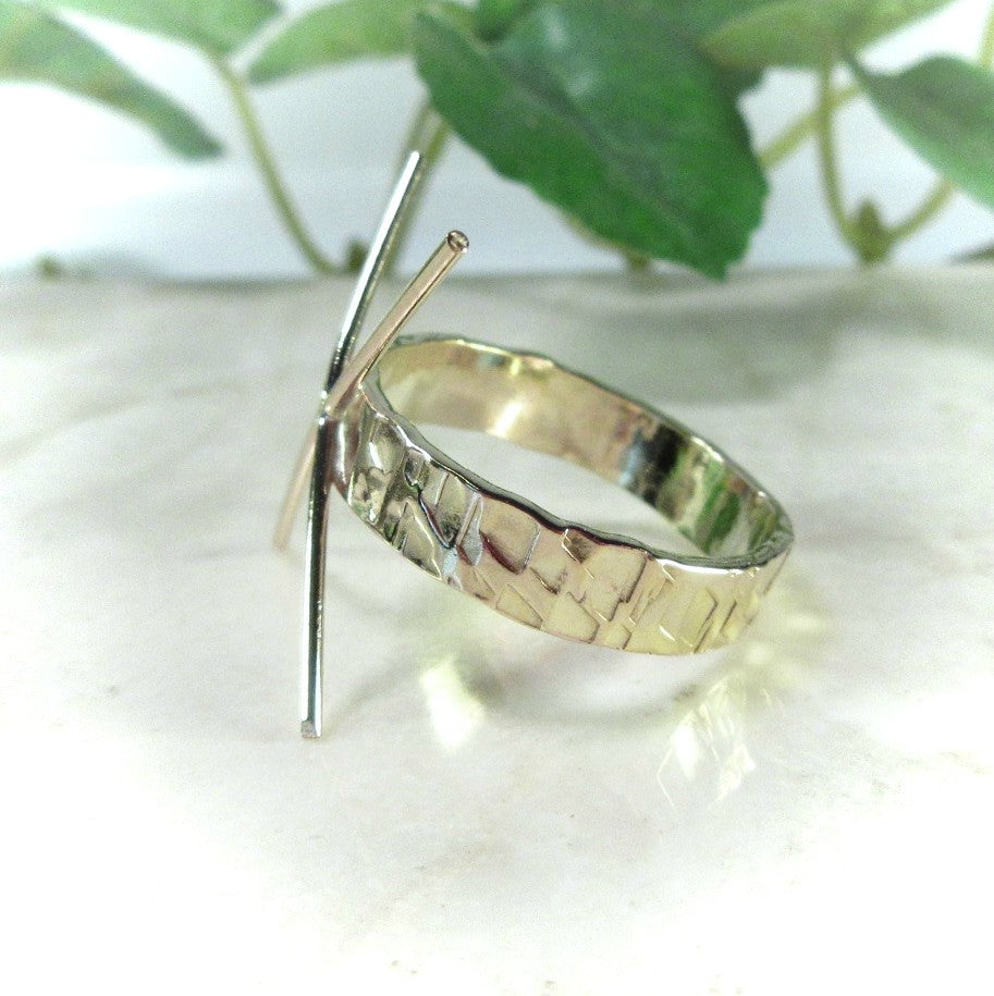 side view of gold chiseled raw gemstone ring setting