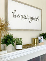 Petal Lane Home Vintage Be Our Guest Home Sign Above Mantel in Room