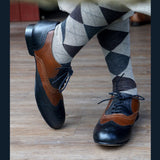 Men's black and brown wingtips and vintage socks