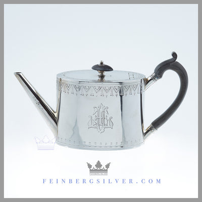 Feinberg Silver - The antique English silver plated bachelor teapot is of an oval neo-classical form with a flush hinged lid with a baluster form and ebony finial, ebony handle with a thumbpiece and a straight angular spout.