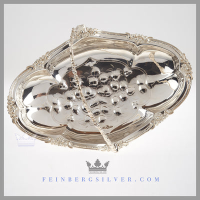 Feinberg Silver - The English silver plated oval, reticulated basket has an applied scroll and leaf border.