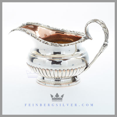 Feinberg Silver | The round, 1/2 fluted creamer has an applied gadroon and shell border and an acanthus loop handle.