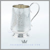 The silver plated child's mug/cup is round with a slightly tapered body with a fluted bottom. Feinberg Silver