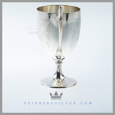 The English silver plated vase shaped mug stands on a pedestal foot with a scroll handle with beading. Feinberg Silver