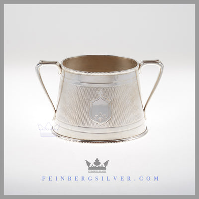 The English silver plated sugar bowl is oval, engine turned with a plain oval center shield on both sides. Feinberg Silver