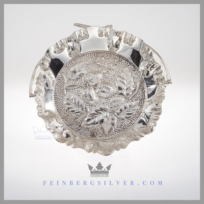Feinberg Silver - The round English silver plated basket has a swing handle with Scottish thistles on the top of the handle.