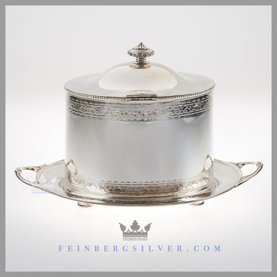 The oval English silver plated biscuit box has 2 cast handles. Feinberg Silver