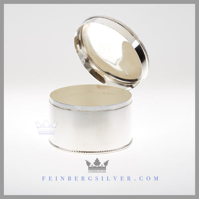 Feinberg Silver - The simple, round English silver plated biscuit box - tea caddy is plain with a gadroon border on the top and bottom.