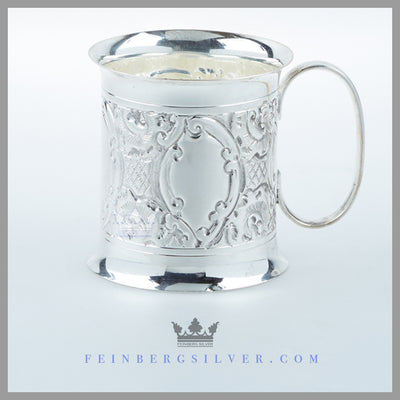 Feinberg Silver - The Antique English Silver Child's Mug's body has a splay top and bottom rim.