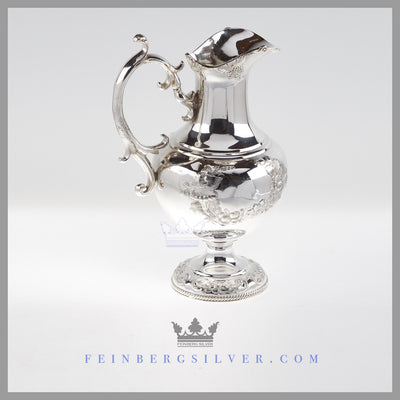 Feinberg Silver - The round, swan neck silver plated water pitcher stands on a hand chased, gadroon bordered pedestal base.