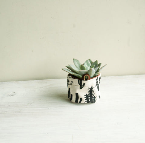 Small heavy weight white canvas bucket with handprinted black cactus pattern