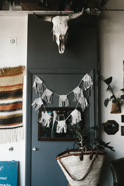 Two strands of 5 macrame pennants