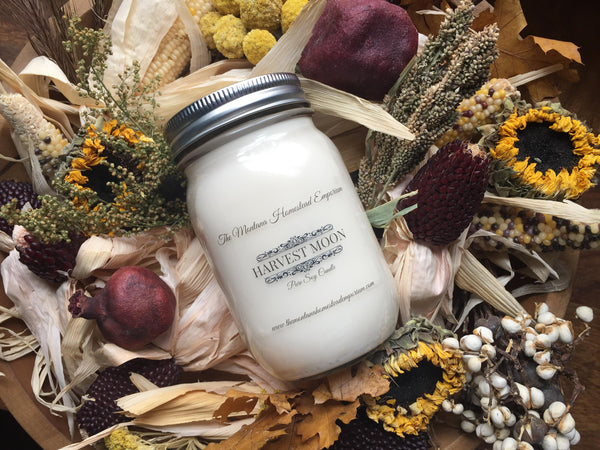 Harvest Moon scented soy candle atop beautiful dried florals