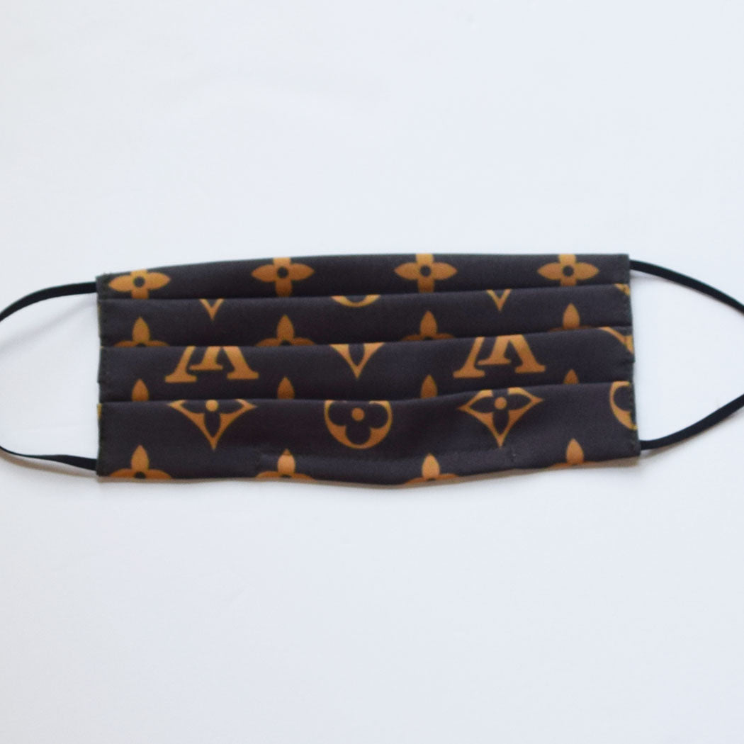 Louis Vuitton Black and Gold Mask