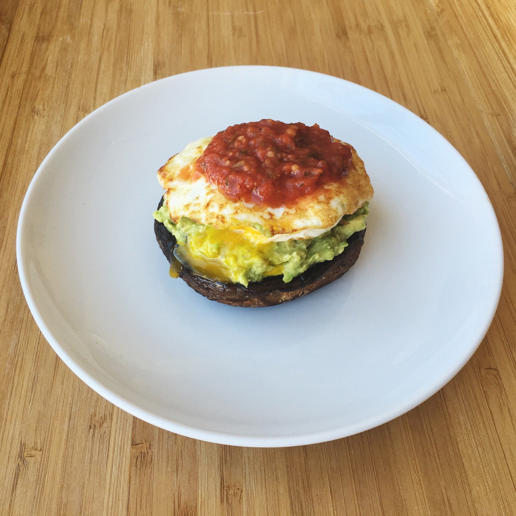 Portabello Mushroom stacked with Guac, Egg and Thai Salsa