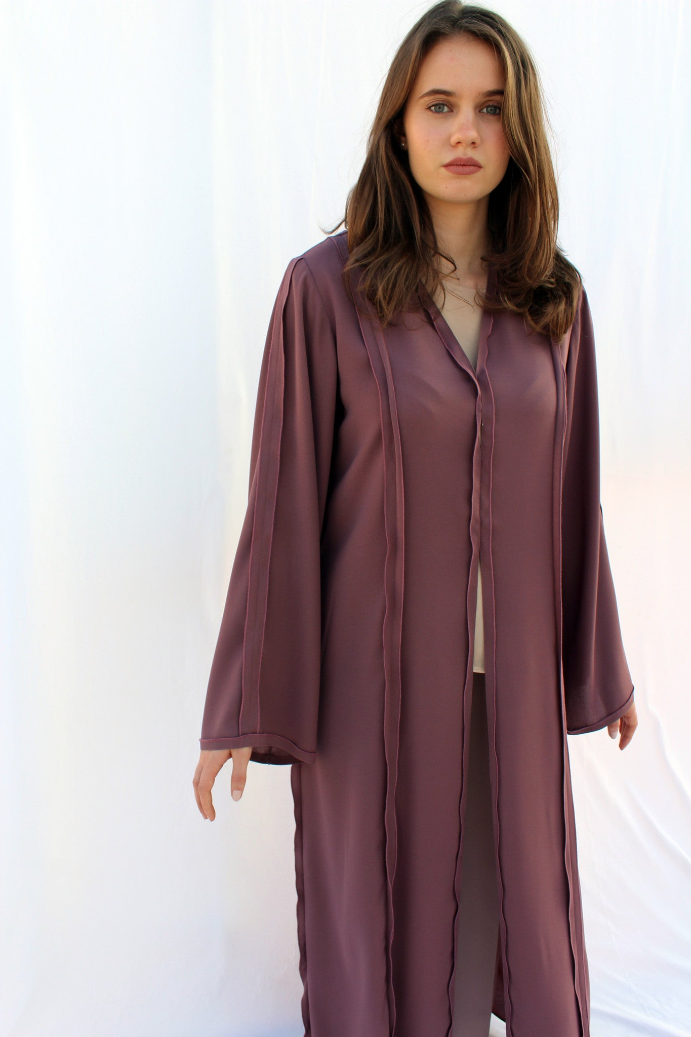 ELIZABETH - AMM1952F - Arabesque Classic cut abaya shape in full colored fabric embellished with multiple joints with inside-out finishing in front, back and sleeves.