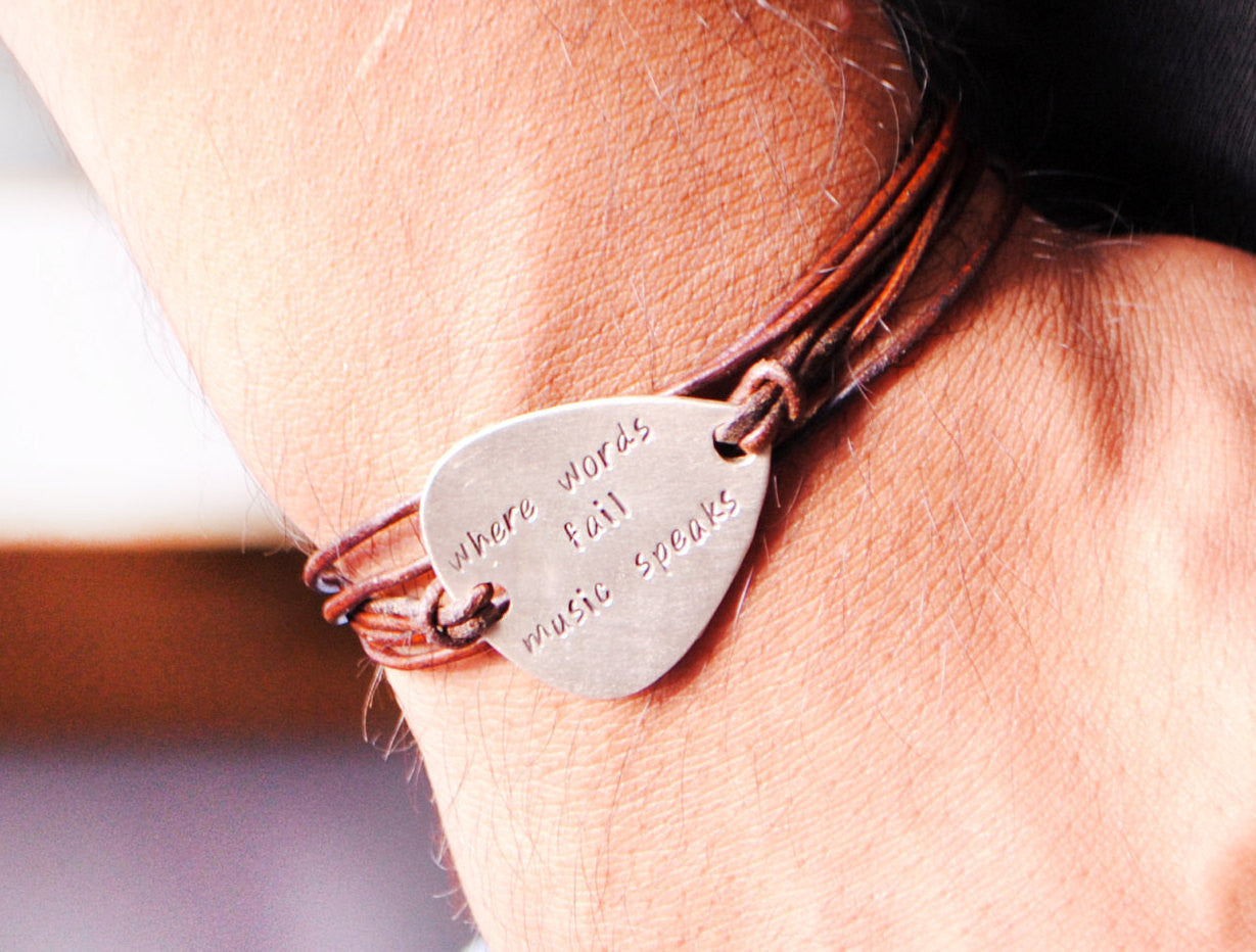 a15aa35677e5 Hand Stamped · Where Words Fail Music Speaks. Personalized Guitar Pick  Leather Bracelet For Men.