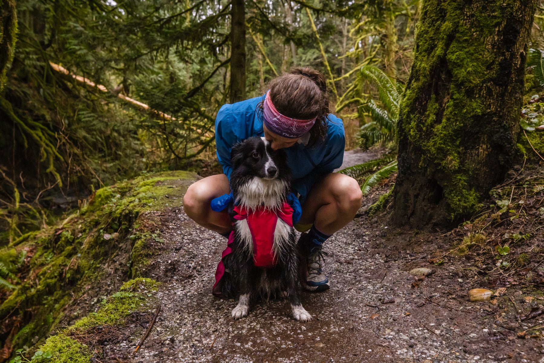 Krissy and her dog PD pause in the trail for a break.