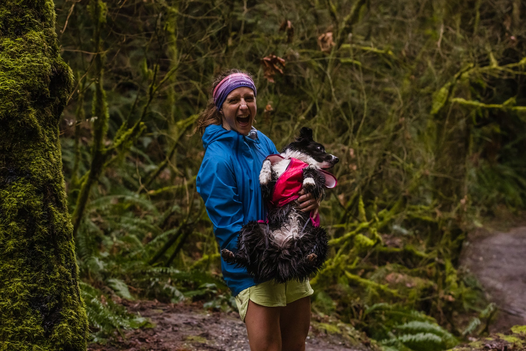 Krissy holds PD up to show how wet and muddy she gets on the trail