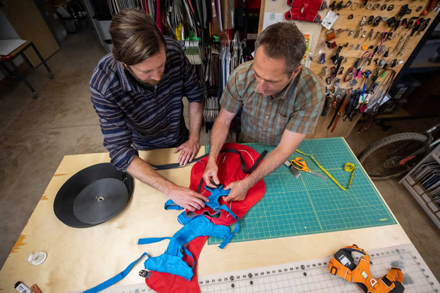 Product team members make a prototype of a harness jacket fuse.