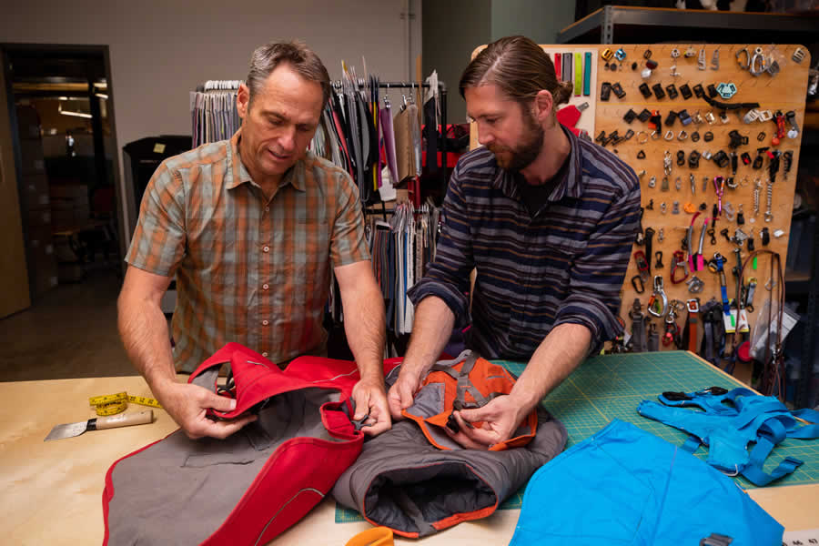 Product designers compare fabrics on prototypes of overcoat fuse.