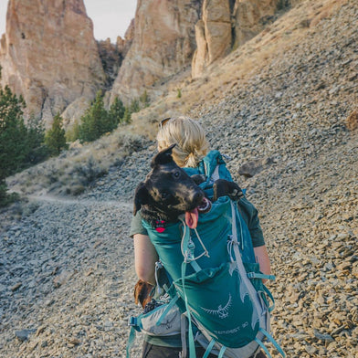 Ambassador Elena Pressprich with Baya on a rocky trail.