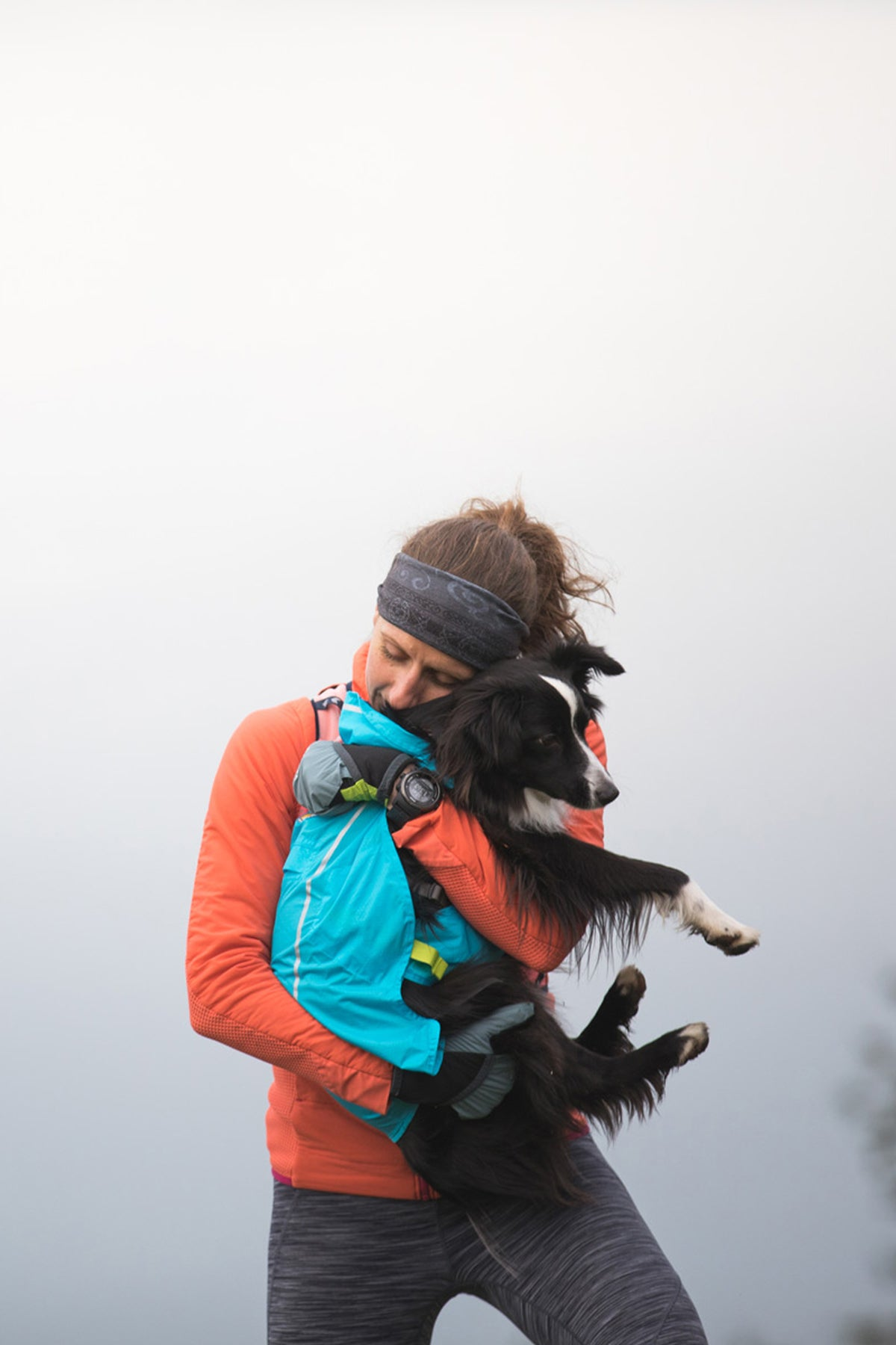 Krissy stops for a mid-run snuggle with PD.