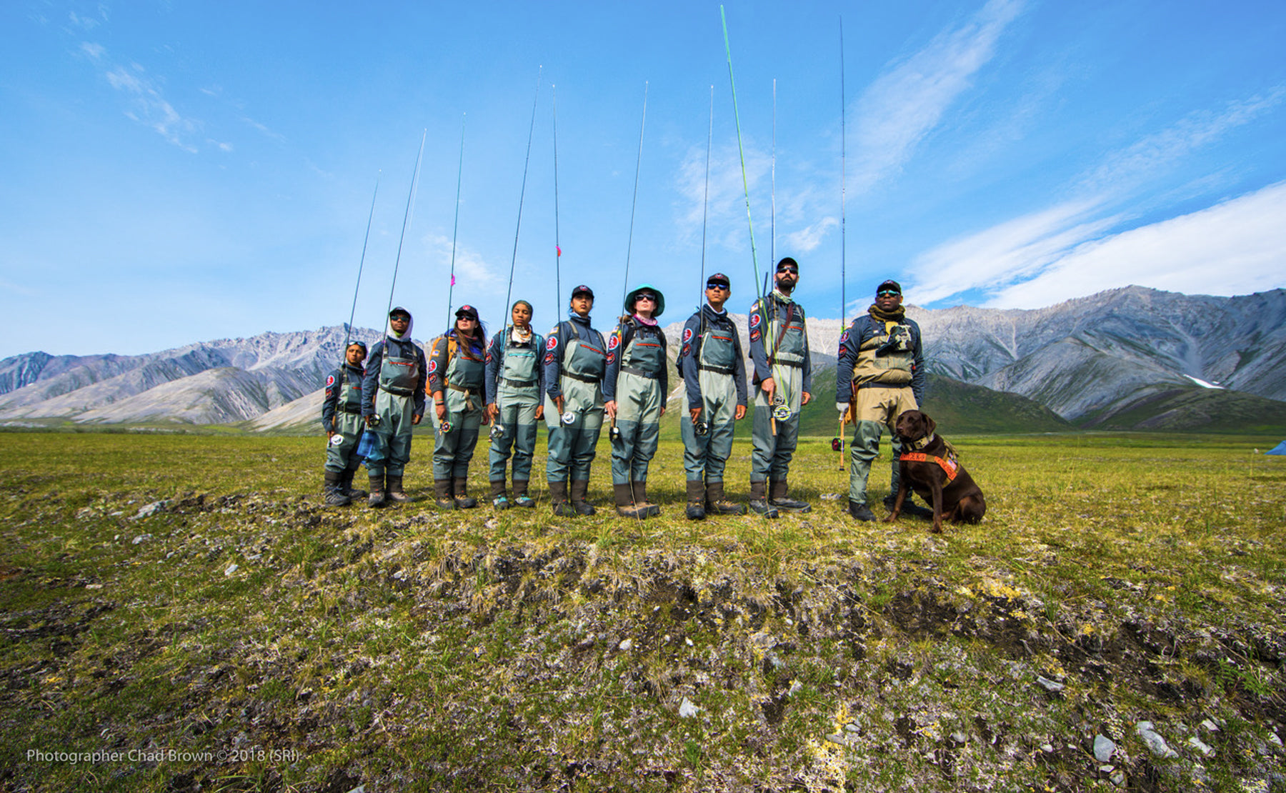 Soul River group in fly fishing gear pose as a group in front of the mountains.