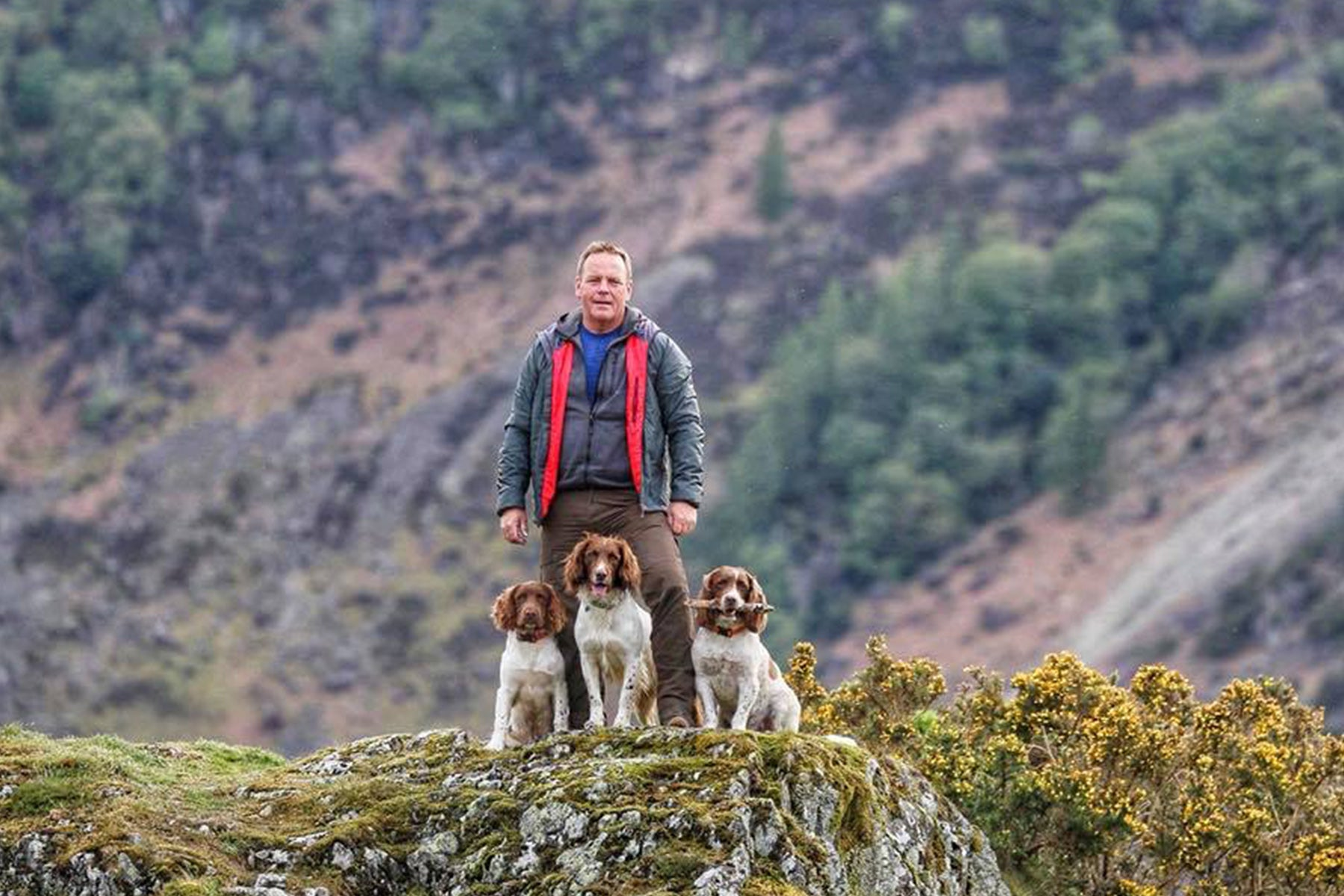 Kerry and his three dogs.