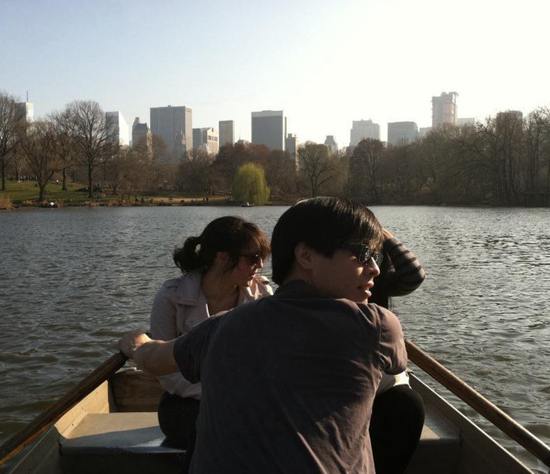 Nathan rows a boat in Central park.