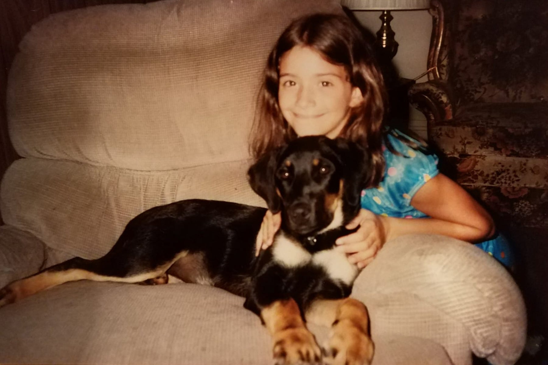 Young Kristen with her family dog.