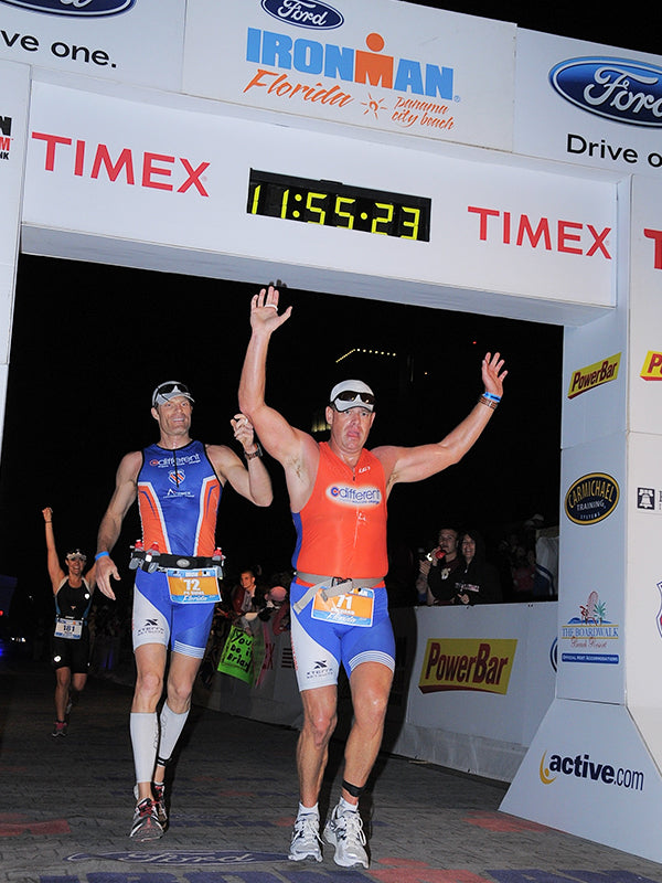 Richard Hunter crossing the finish line at Iron Man with his human guide.