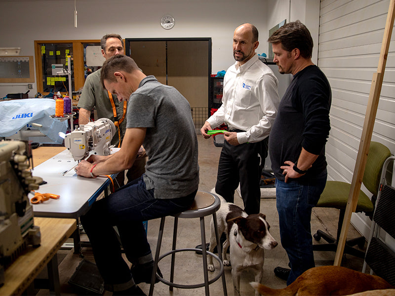 Ruffwear product team in design room sewing and making prototypes.