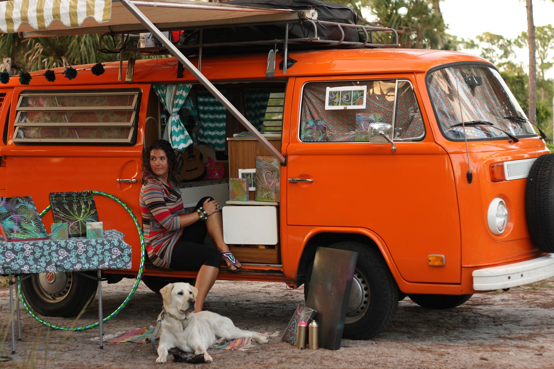 Mallory and Baylor hang out in her orange camper van.