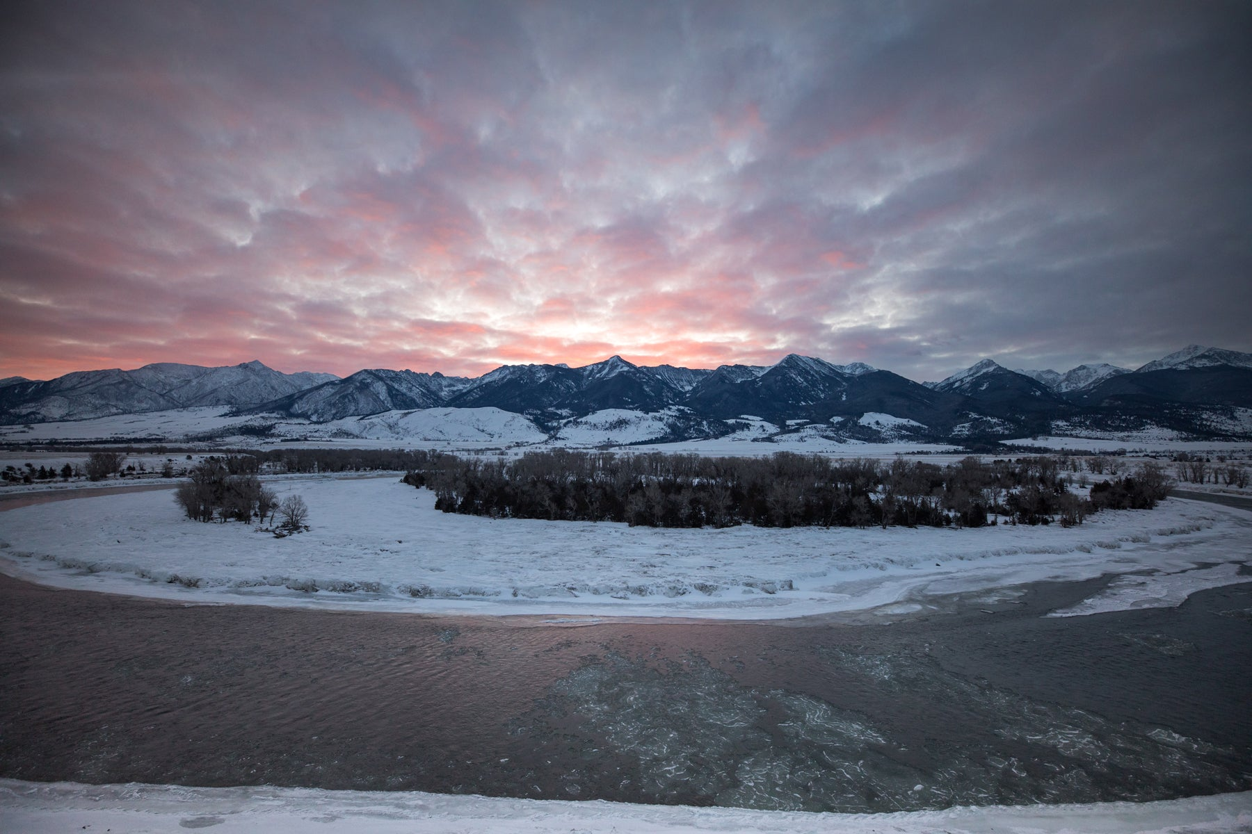 Sunset over snowy mountains in Paradise Valley in Montana.