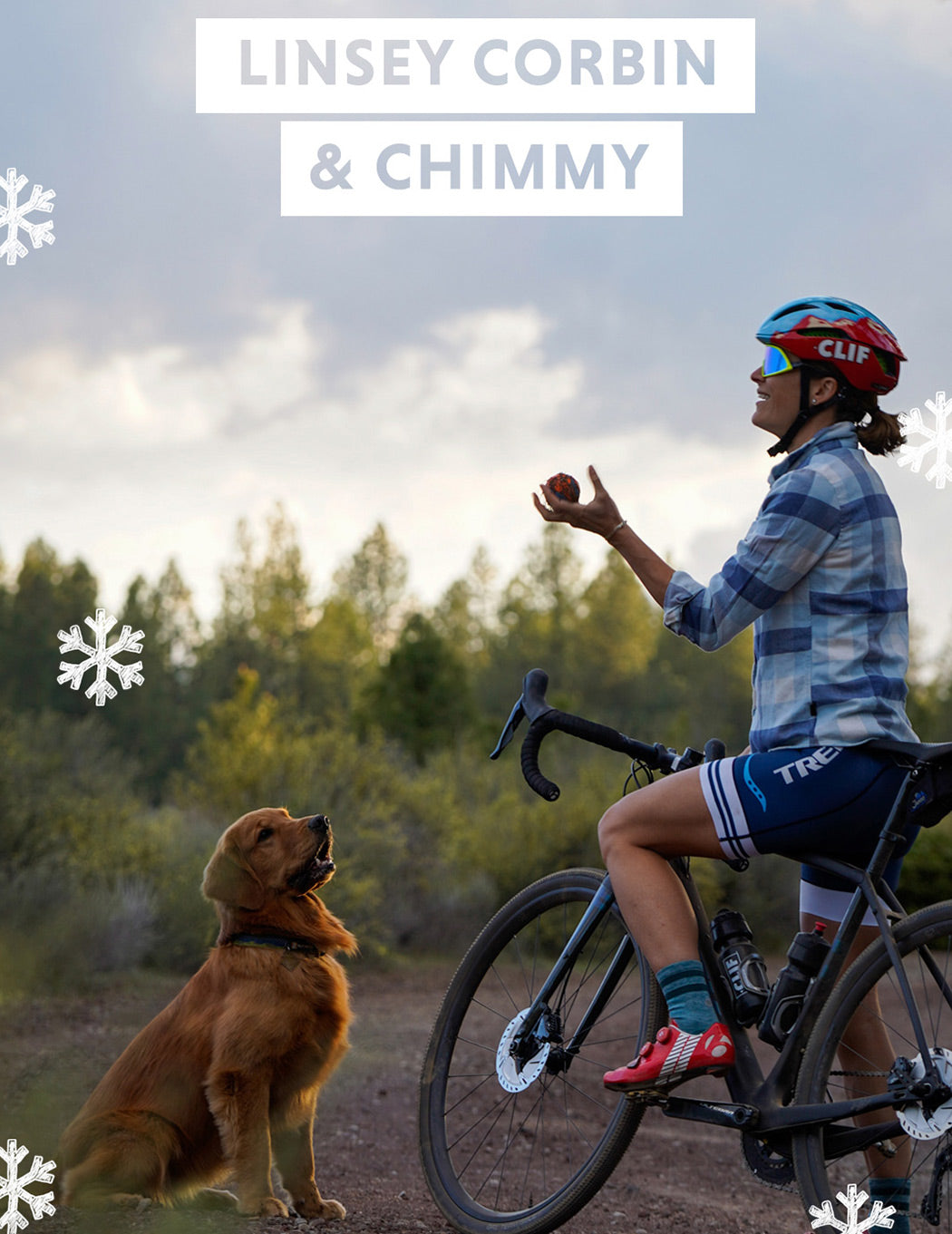 Linsey sits on her gravel bike throwing a ball in the air for Chimmy.
