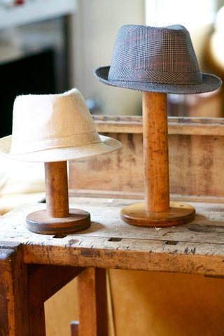 Vintage Wooden Bobbins as Hat Racks