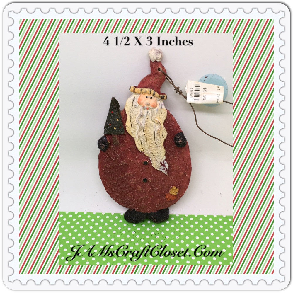Santa Ornament Plaster Holding Christmas Tree With Yellow and Peach Patches on His Coat