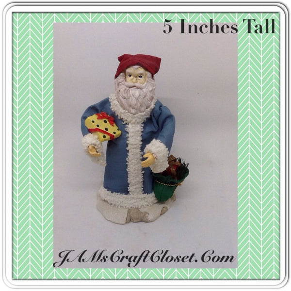 Santa Vintage Blue Red Shelf Sitter 5 Inches Tall Holiday Decor Yellow Package Green Bag  This vintage blue and red shelf sitter Santa is 5 Inches tall and is carrying a yellow package and a green bag of goodies. JAMsCraftCloset
