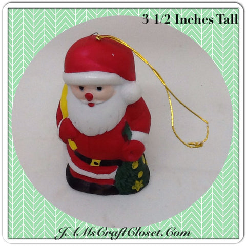 Vintage Santa Shelf Sitter Stands 3 1/2 Inches Tall Holding Yellow Bag Christmas Tree Holiday Decor