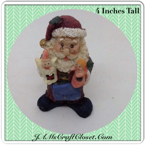 Vintage Santa Shelf Sitter Holding an Angel and Doll...This little guy is a poor Santa.  His toes are coming through his shoes and his outfit has a few patches. Holiday Christmas Decor JAMsCraftCloset