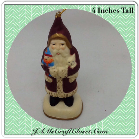 Vintage Santa Shelf Sitter or Ornament Holding a Kitty and Doll Great for the Tree