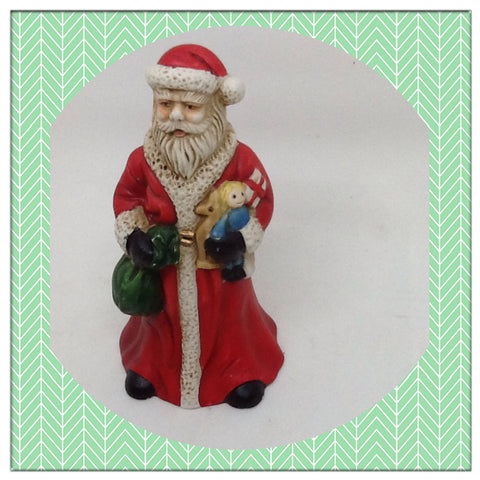 Vintage Ceramic Santa Bell Shelf Sitter Holding a Bag and Baby Doll Great for the Tree